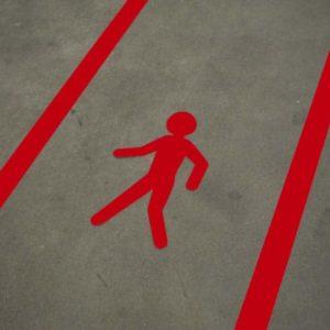Lopende man voetganger vloersticker rood